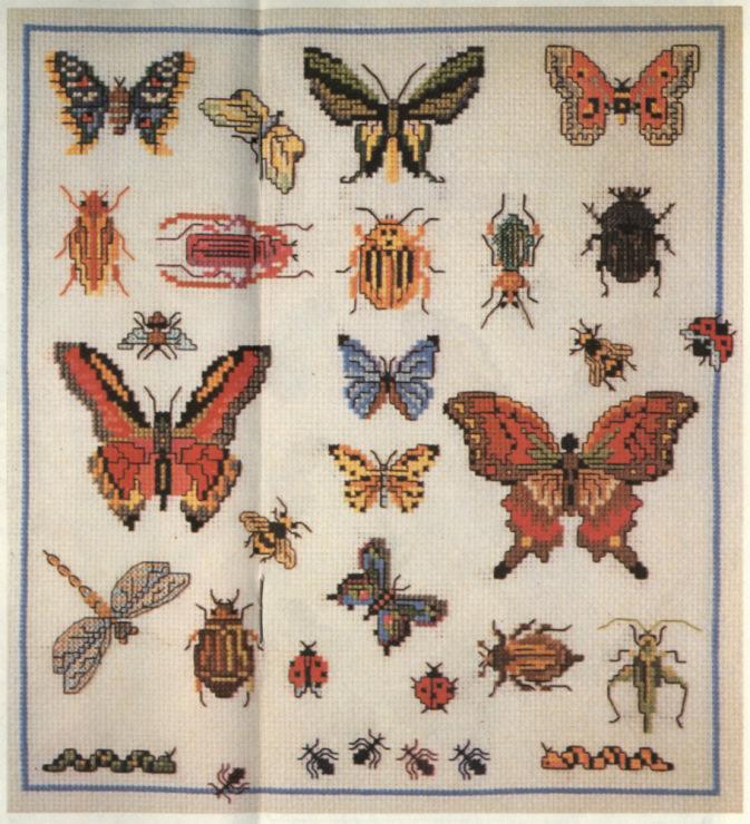 Вышивка бабочки на вязаных изделиях 98